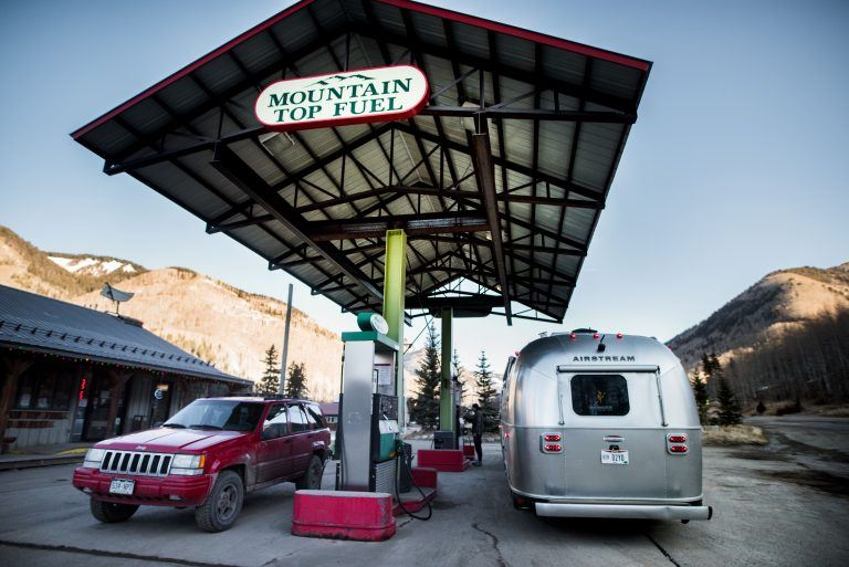 Airstream at Gas Station Refueling the Tow Vehicle Travel Trailer RV