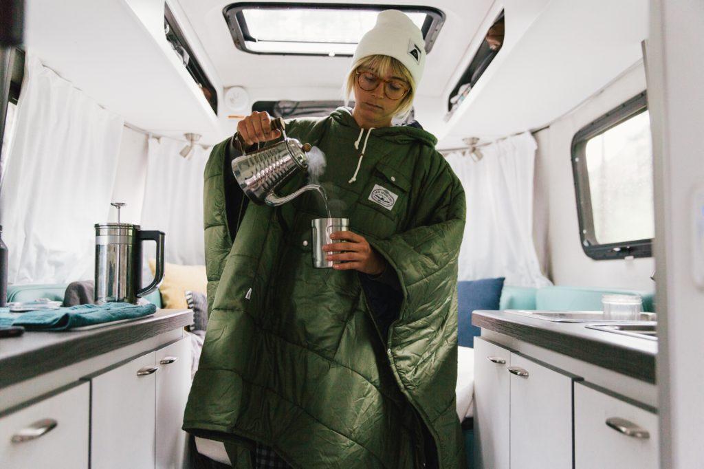 Laura Austin inside Nest Travel Trailer Airstream