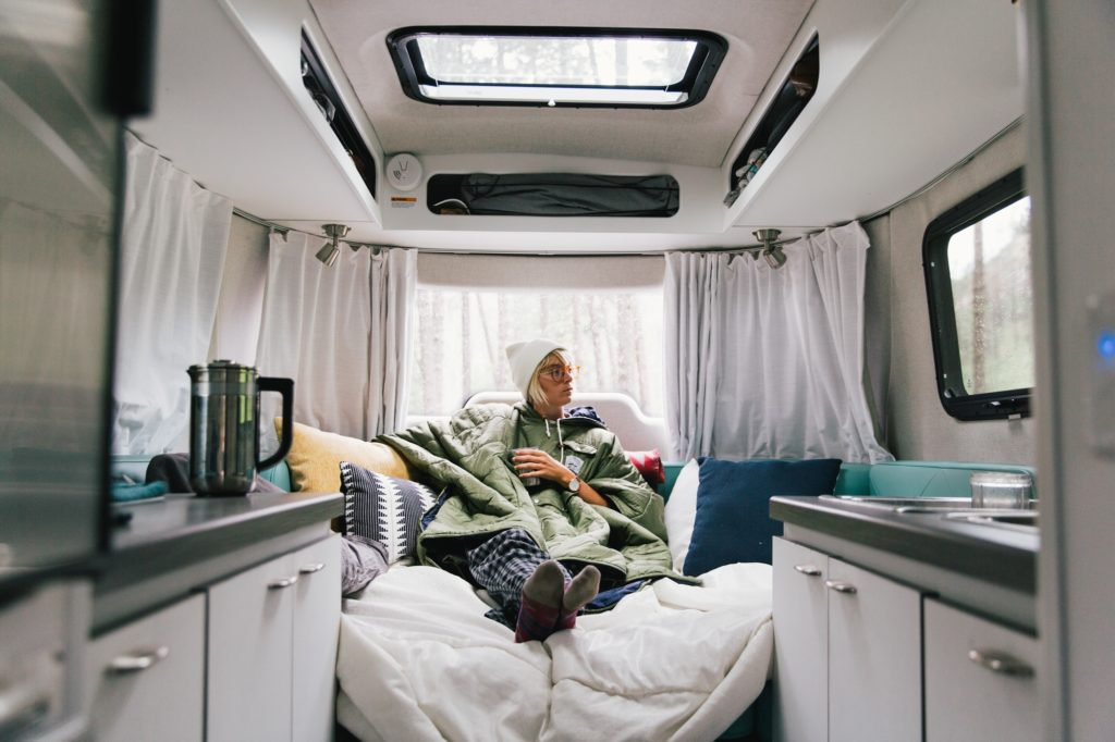 airstream nest 16FB bed made with sheets and pillows