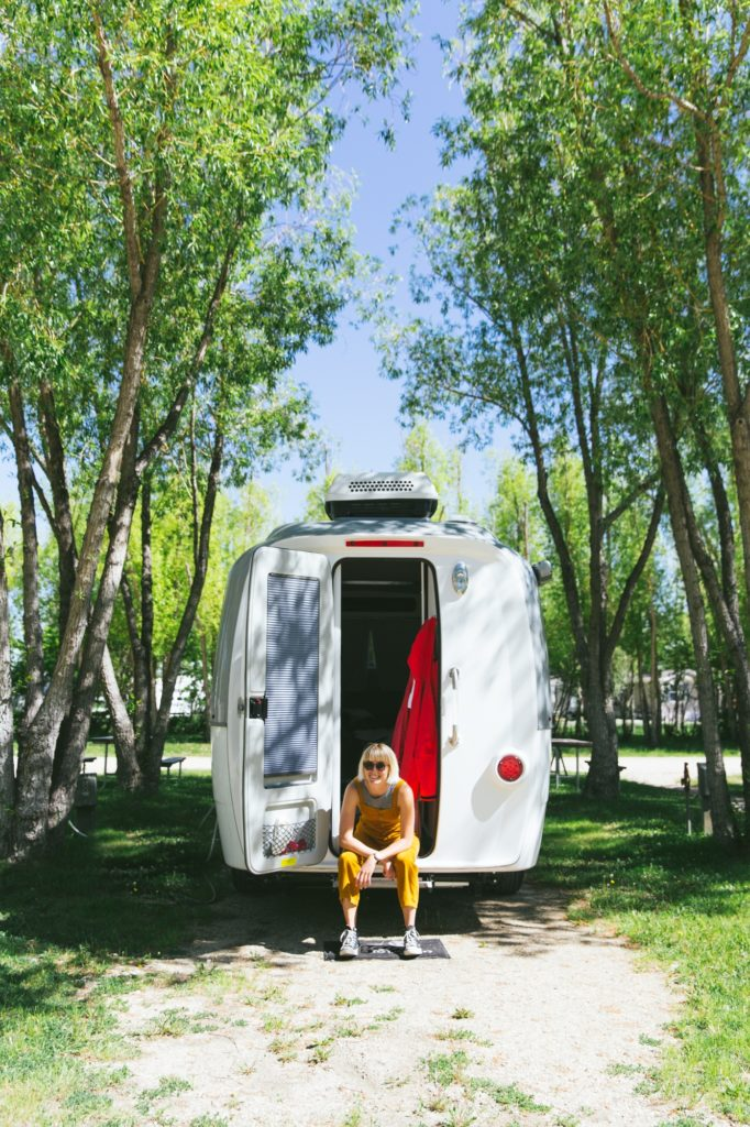nest by airstream travel trailer rear door and laura austin trees at campsite