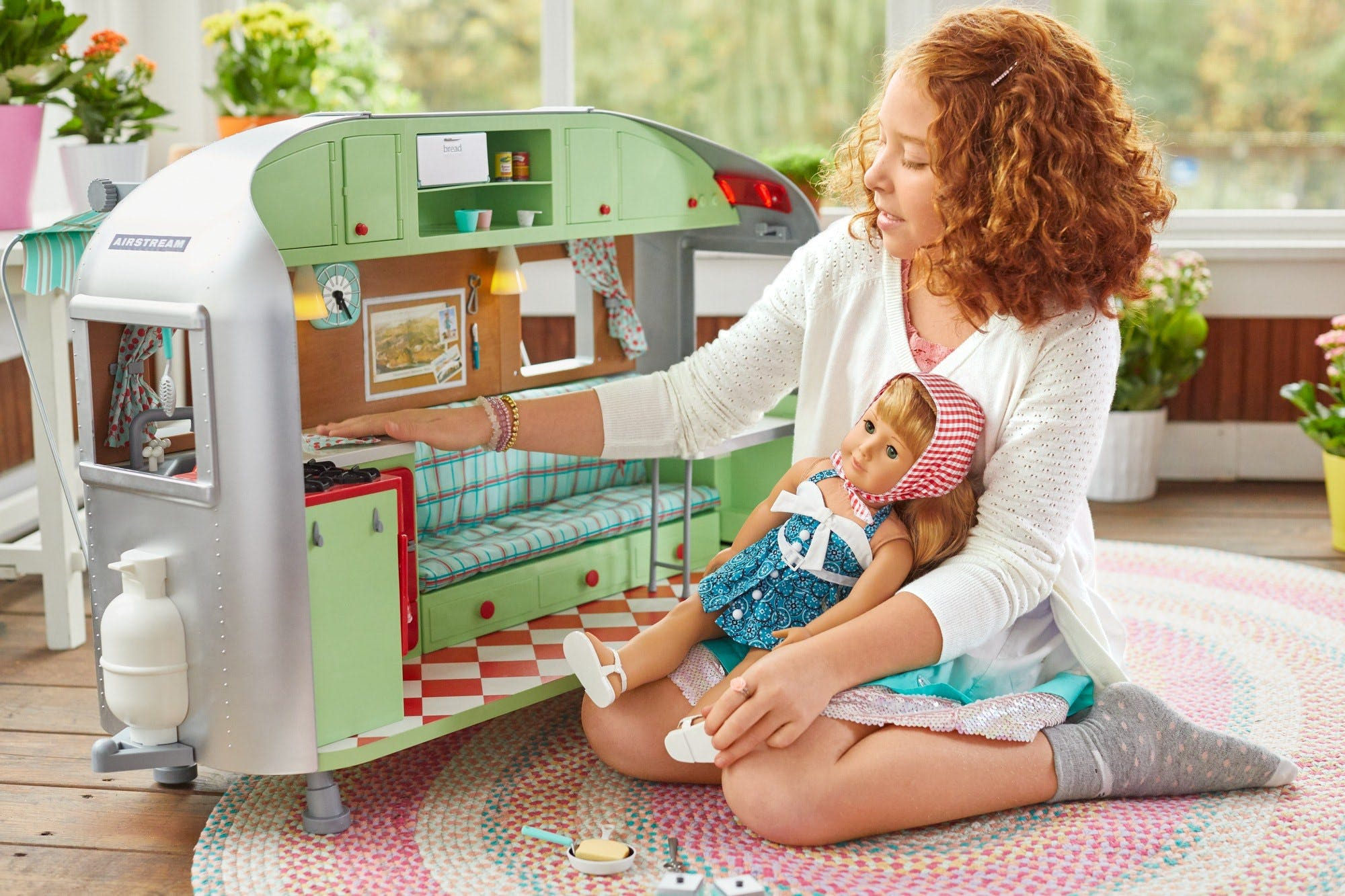 American Girl and Airstream Travel Trailer