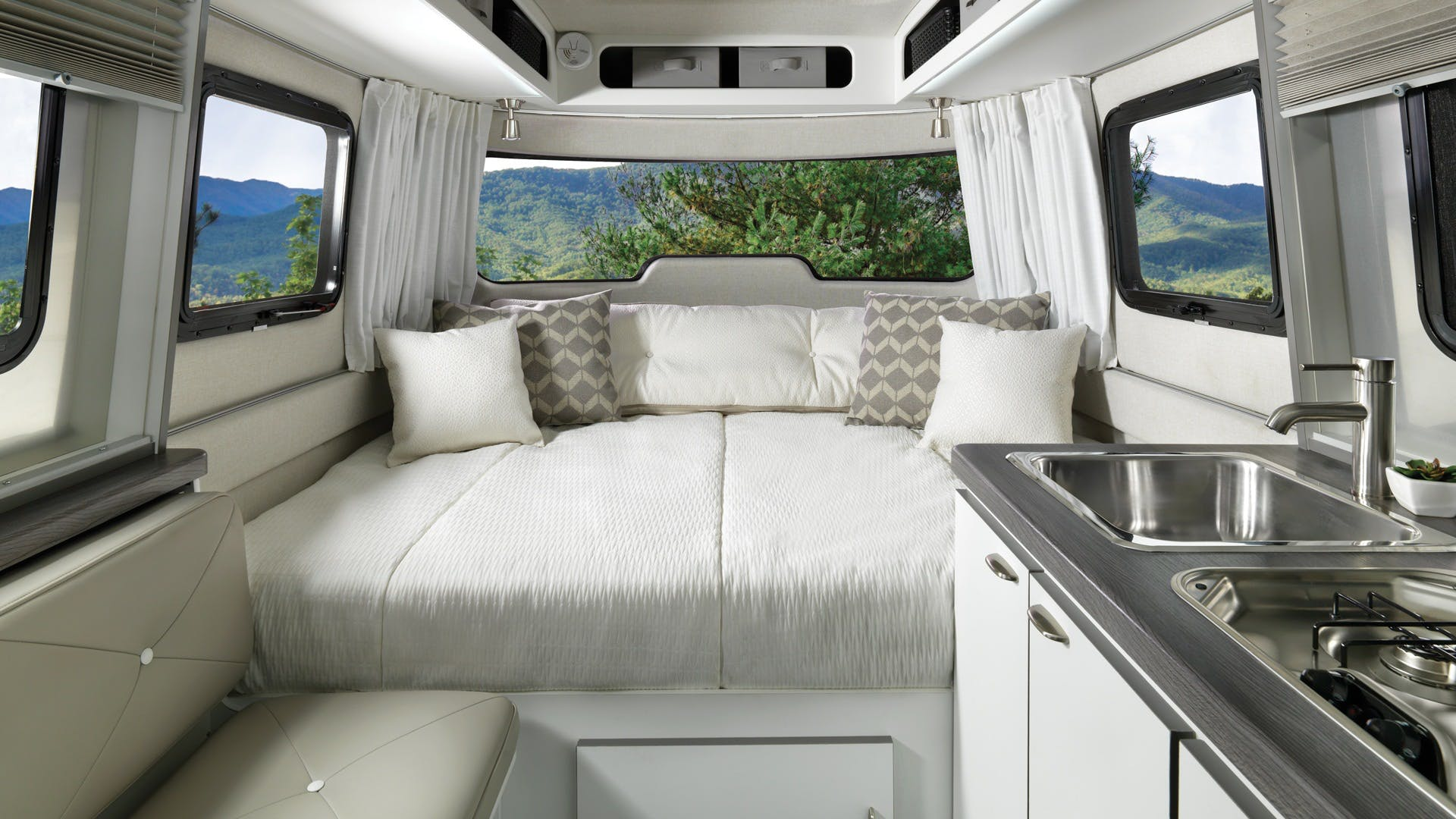 Nest by Airstream wingspan white front bed fixed white covers bed big kitchen sink sofa