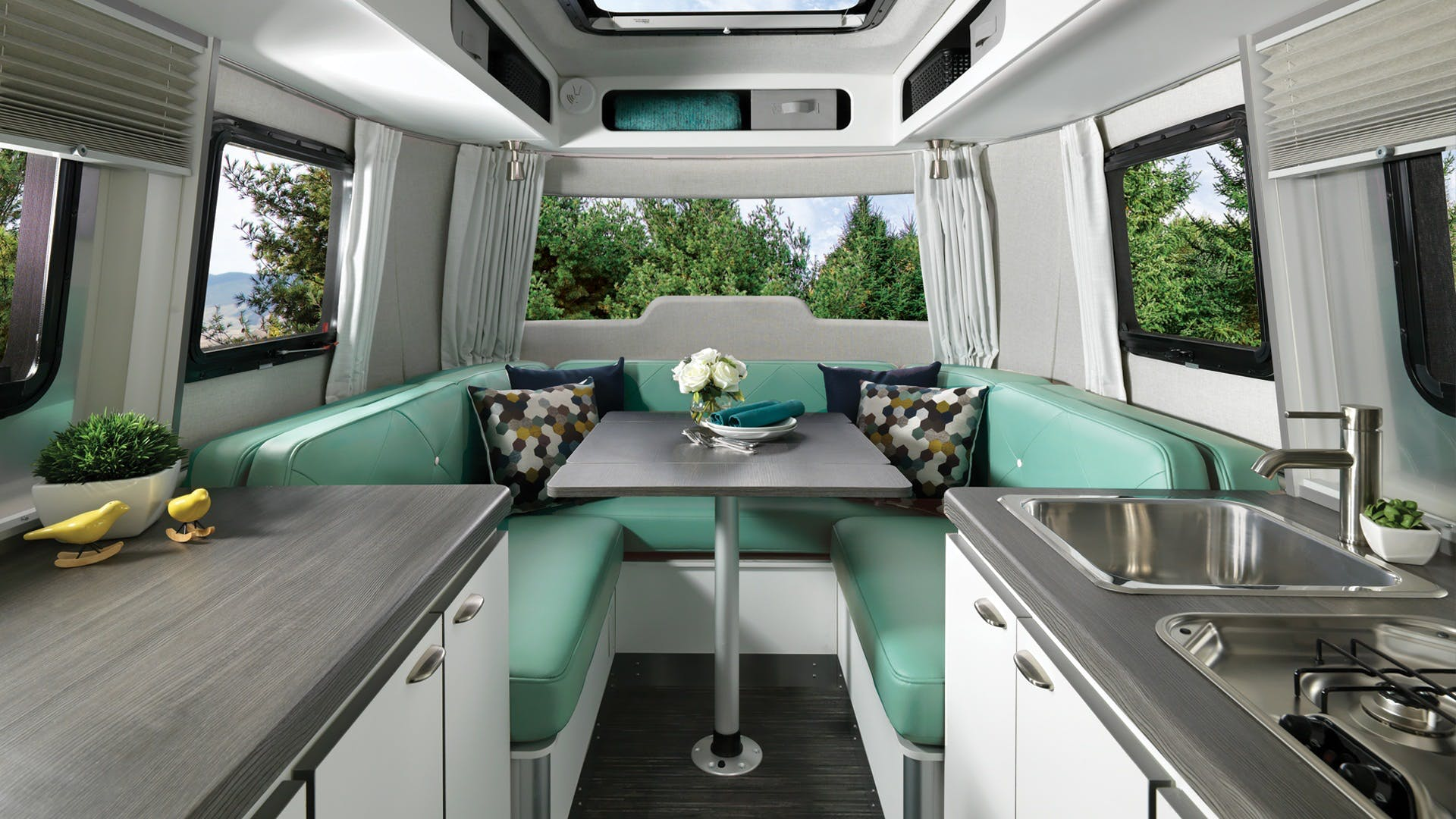 Nest by Airstream clutch blue interior floor plan galley dinette table up