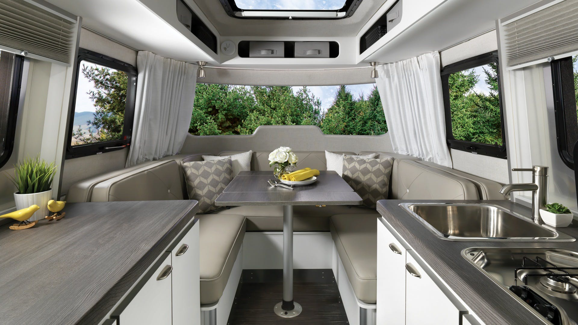 Nest by Airstream wingspan white front dinette table interior floor plan galley
