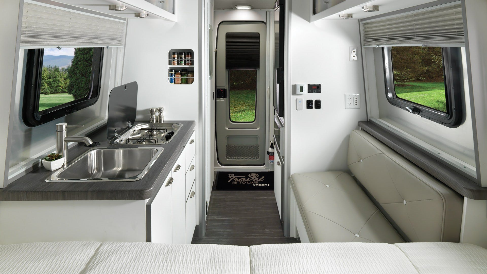 Nest by Airstream wingspan white interior floor plan galley
