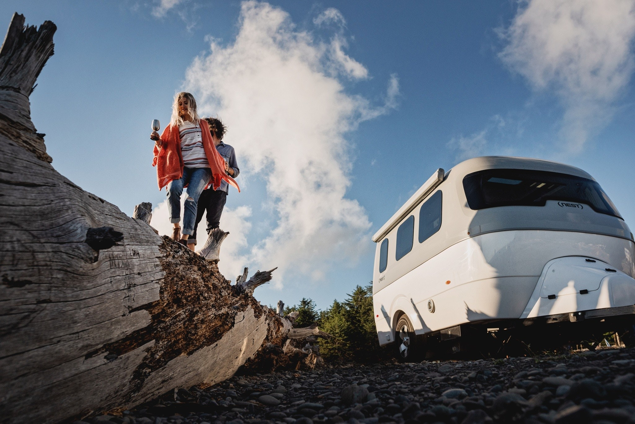 Nest by Airstream sky clouds woman man tree rocks adventure wheels shell awning