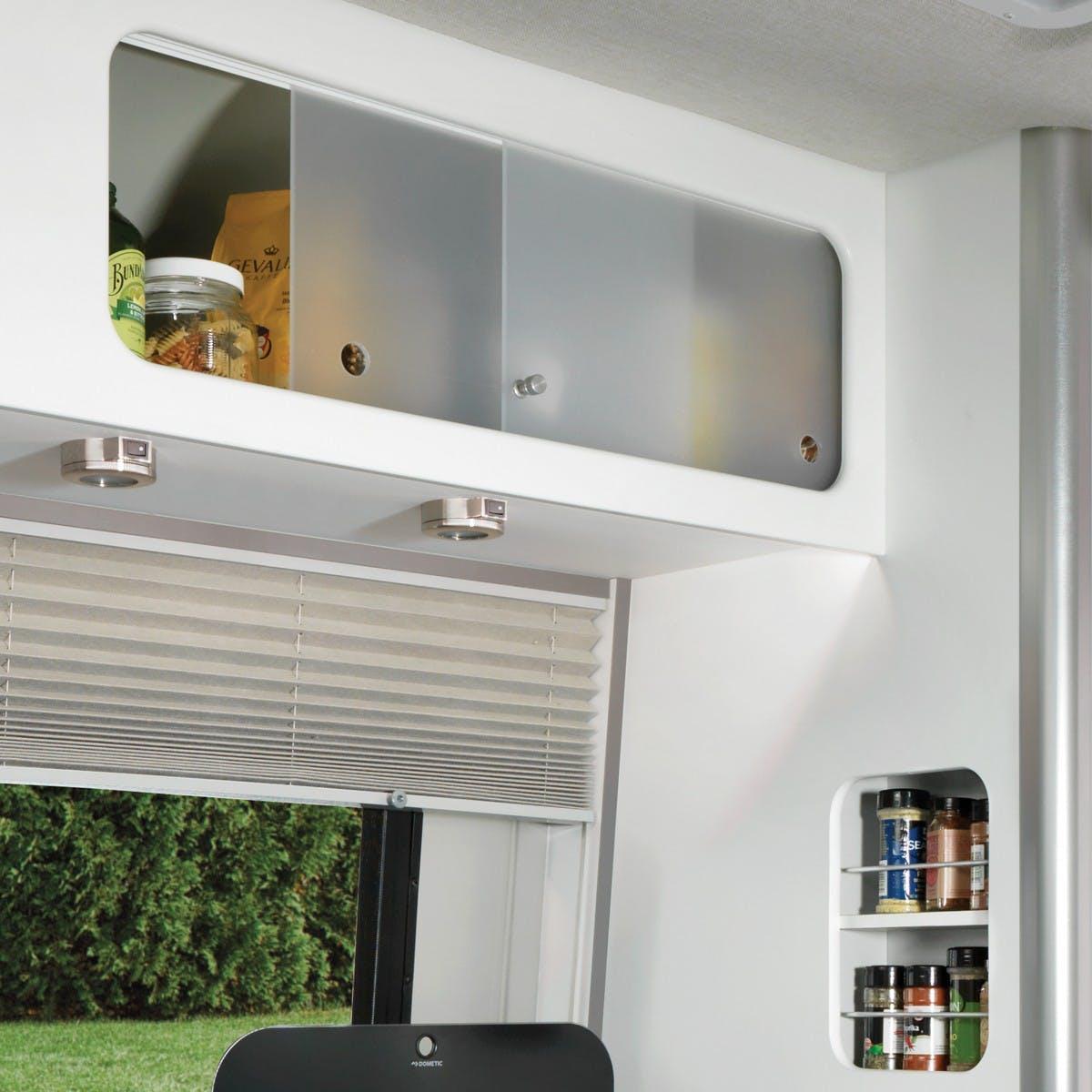 Nest by Airstream above head kitchen storage