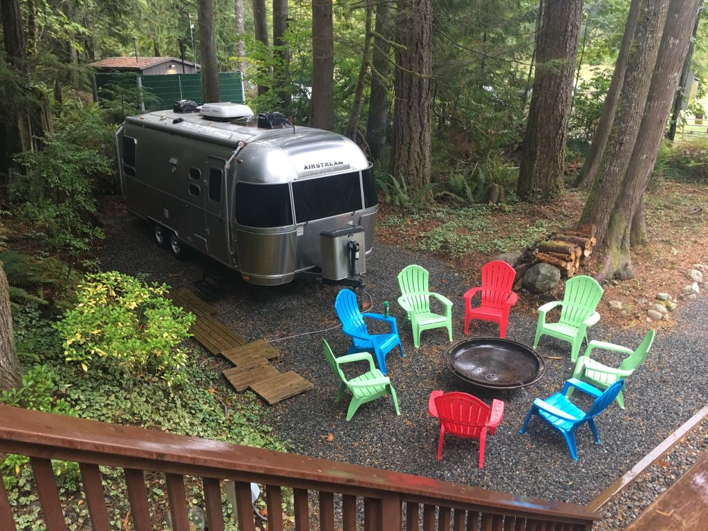 Travel Trailer and Campfire
