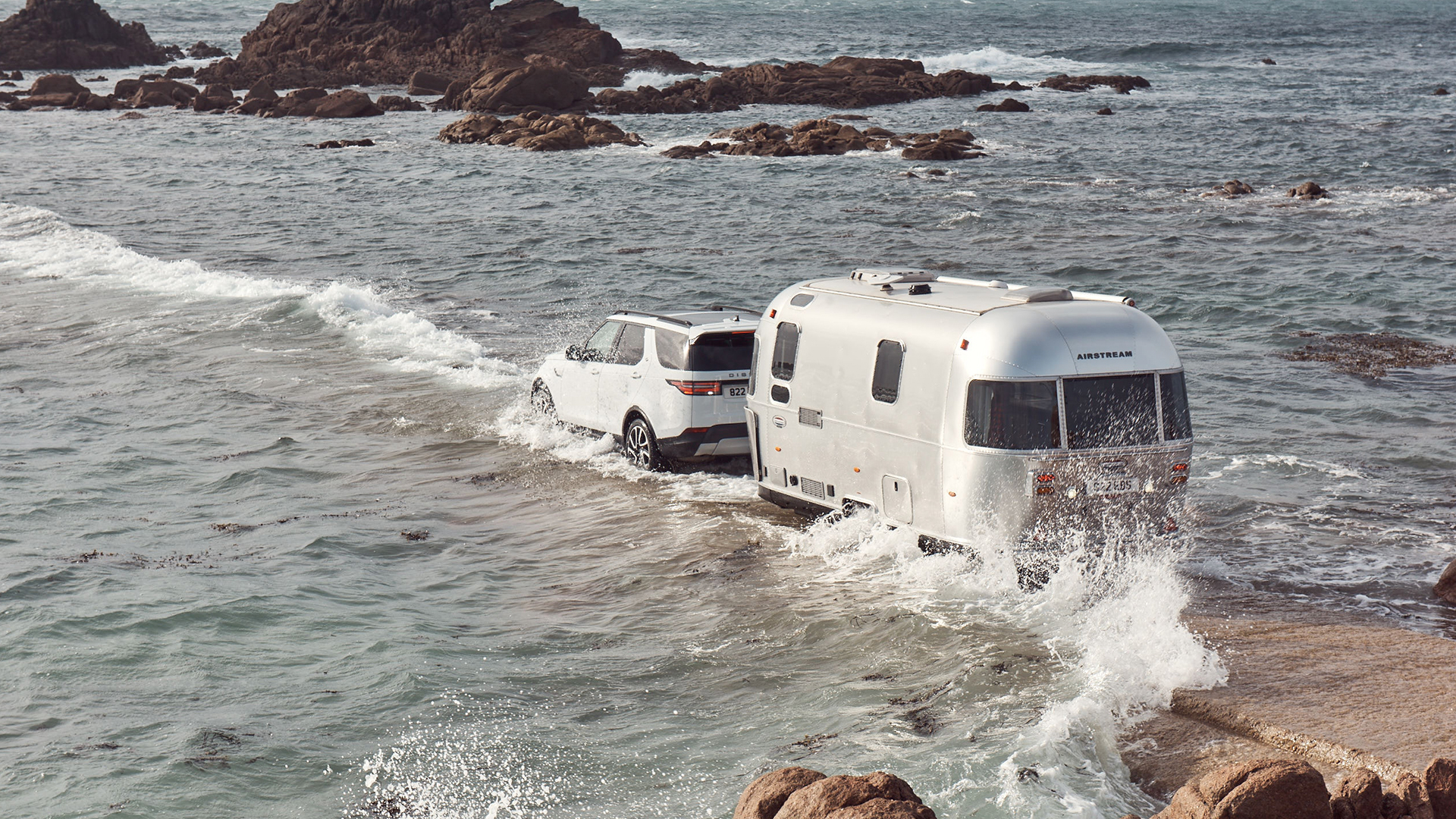 Airstream-Travel-Trailer-with-Land-Rover-Tow-Assist-Technology-in-High-Tide