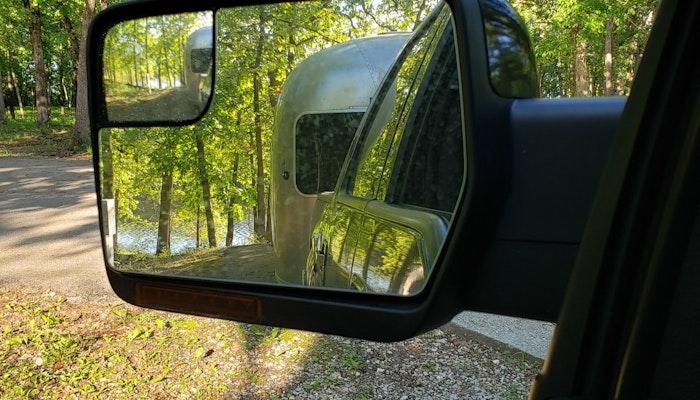 Airstream Travel Trailer in Rear View Mirror