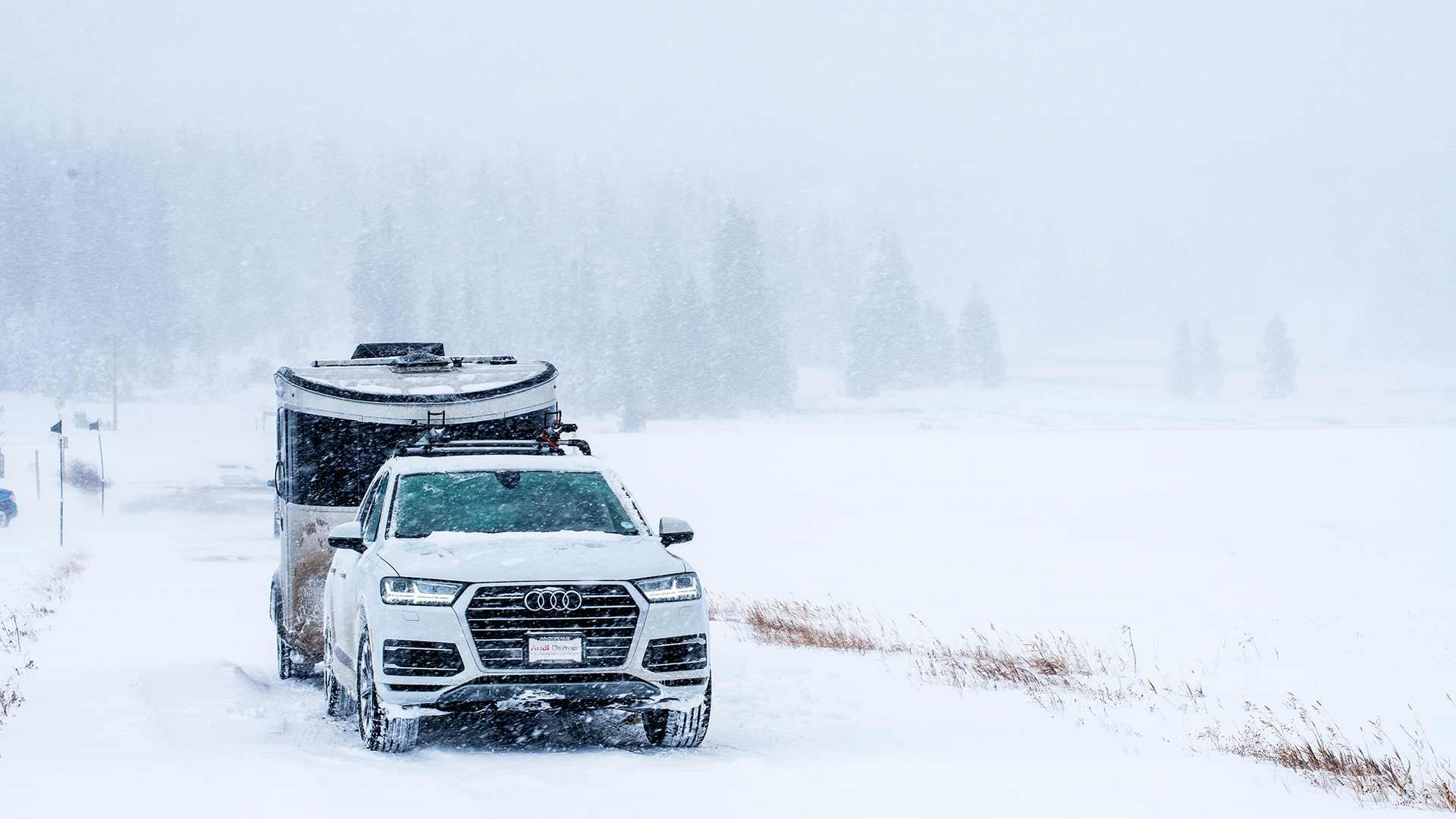 Airstream-Basecamp-Driving-Though-Snow-Audi