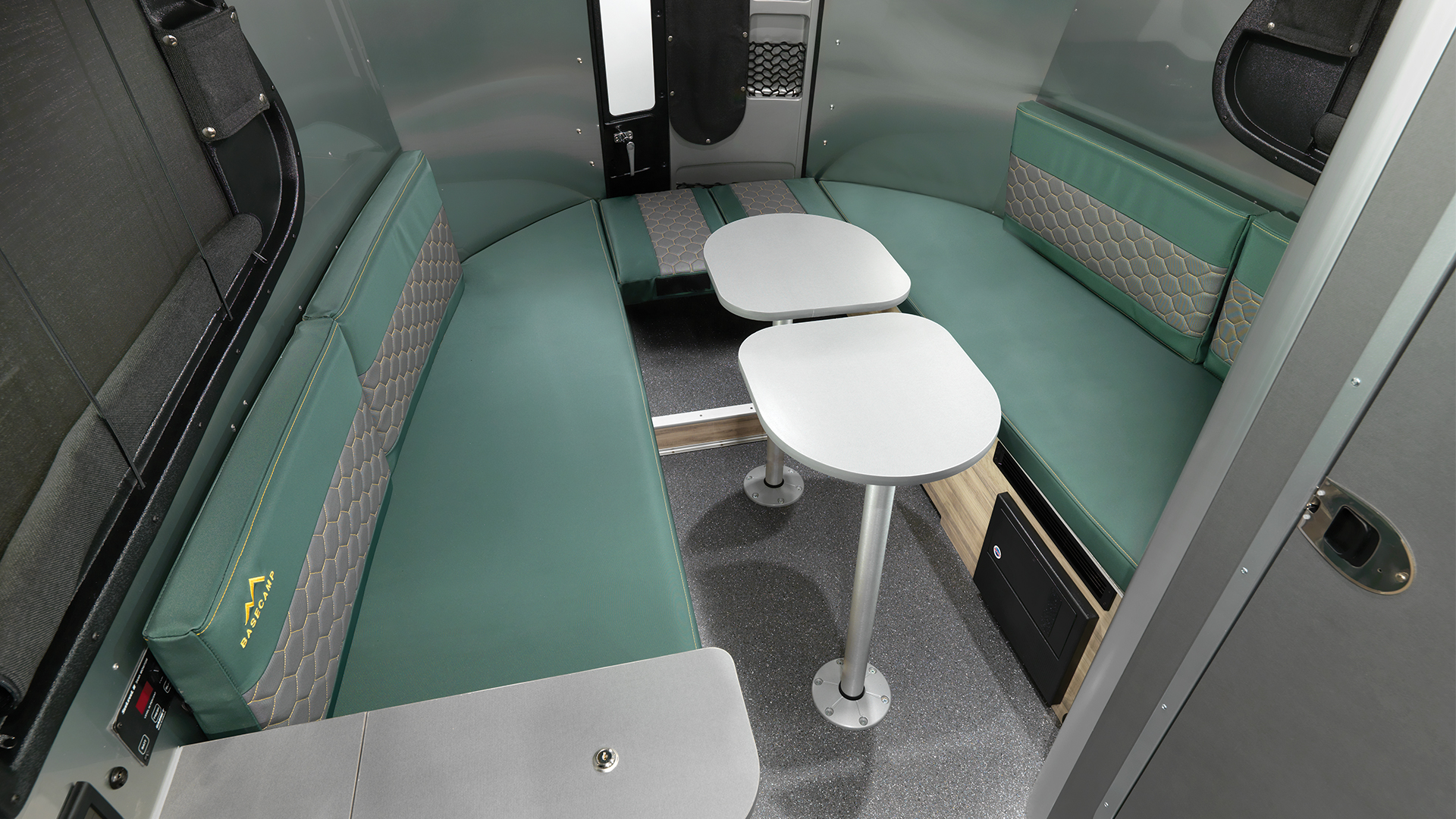 Airstream-Basecamp-Forest-Ridge-Two-Tables-Up-Rear-Seat-Down