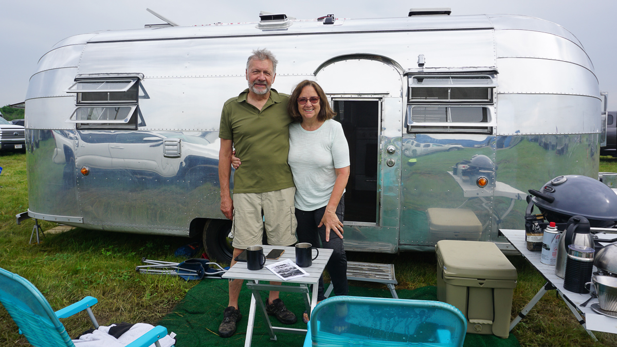 Paul and Lynda Schuepp with Airstream Travel Trailer
