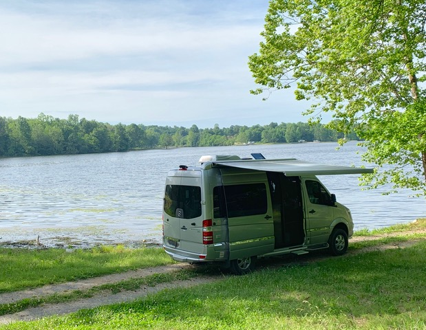 Airstream Interstate Nineteen by a Lake