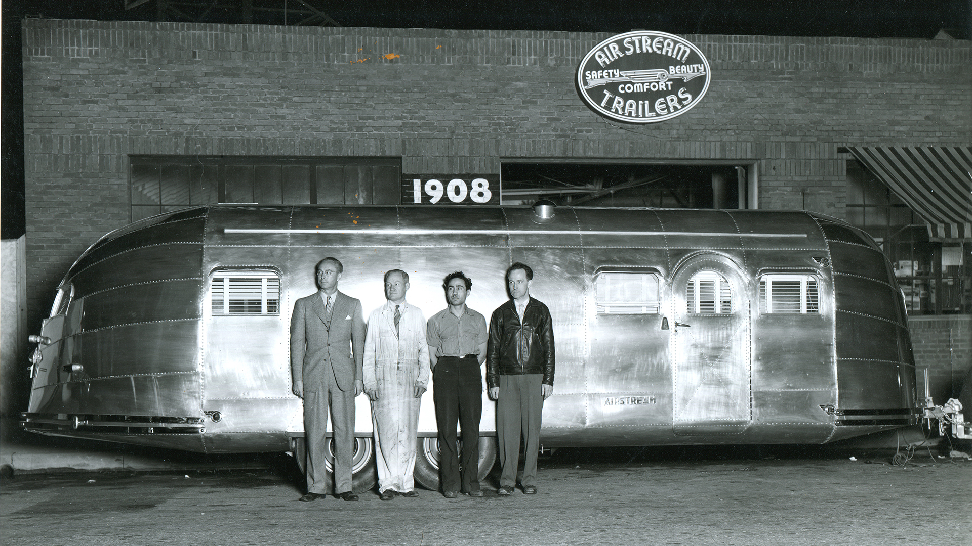 Wally-Unknown-Men-Clipper-Airstream-Factory-1908-Address