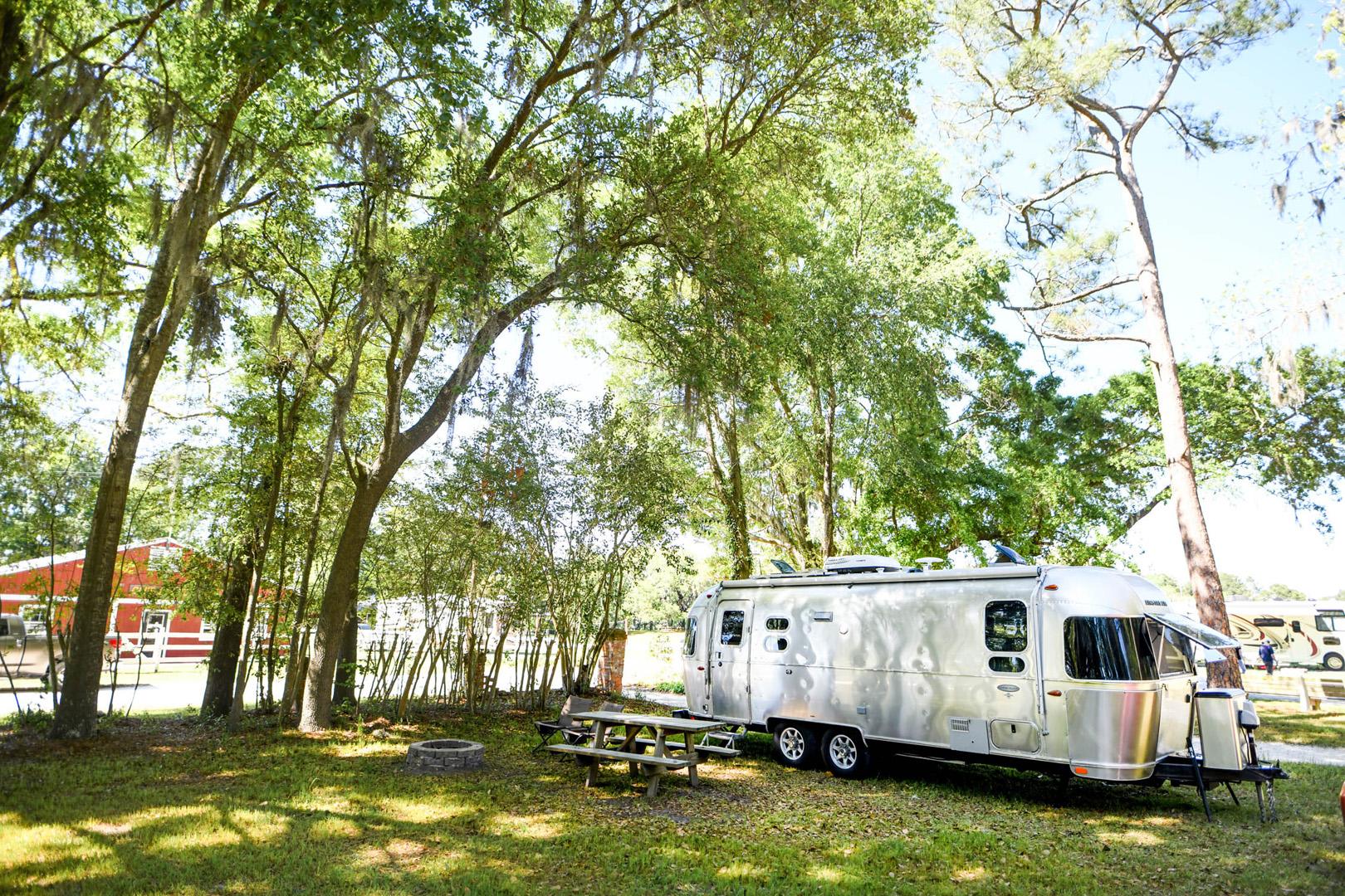 Airstream Travel Trailer RV Camper Trailer Set up at Campsite