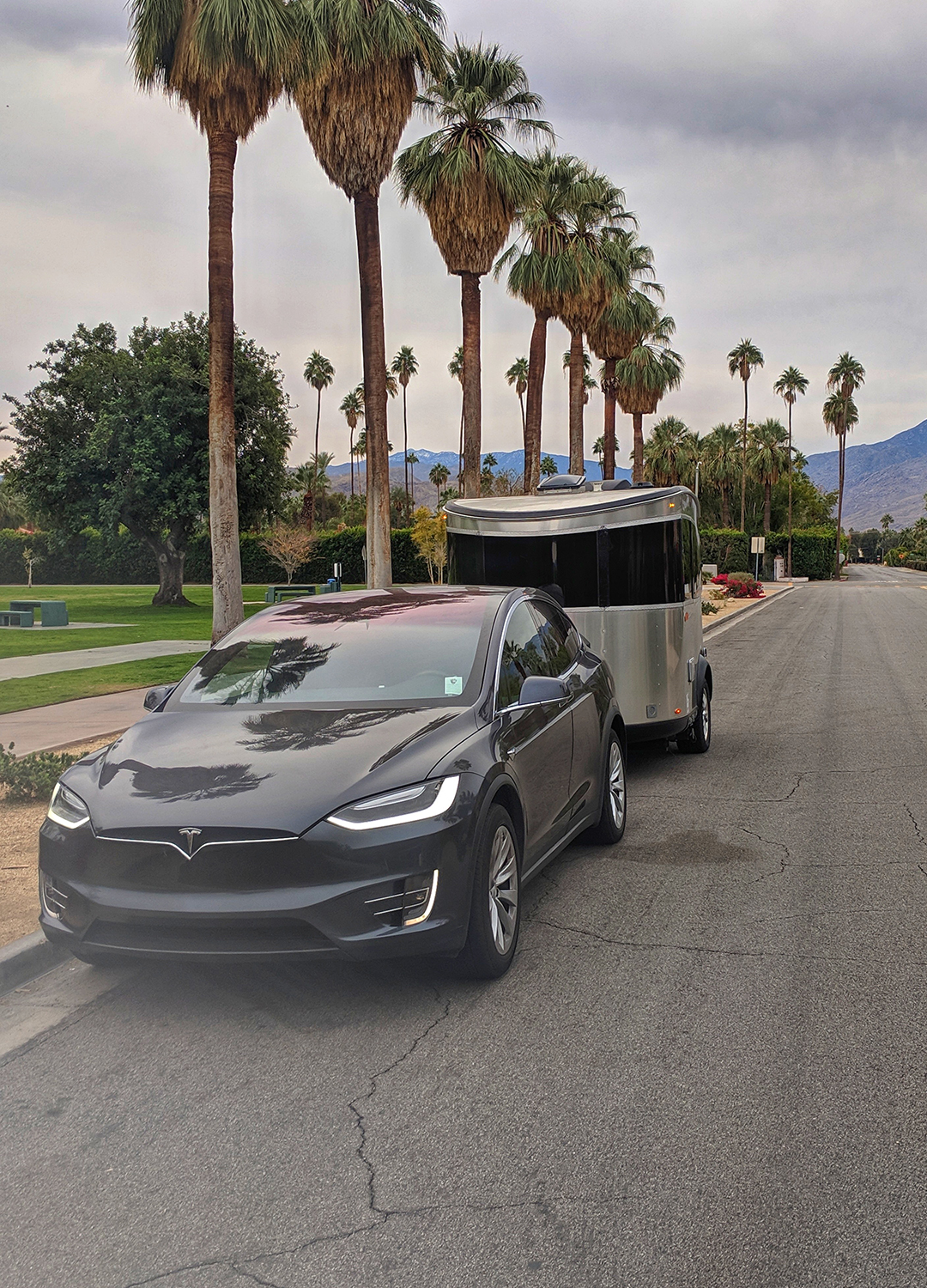 Airstream-Basecamp-and-Tesla-Model-X-on-Road