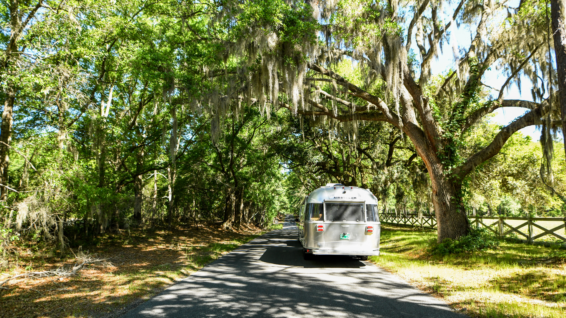 Airstream-Flying-Cloud-on-drive-with-trees