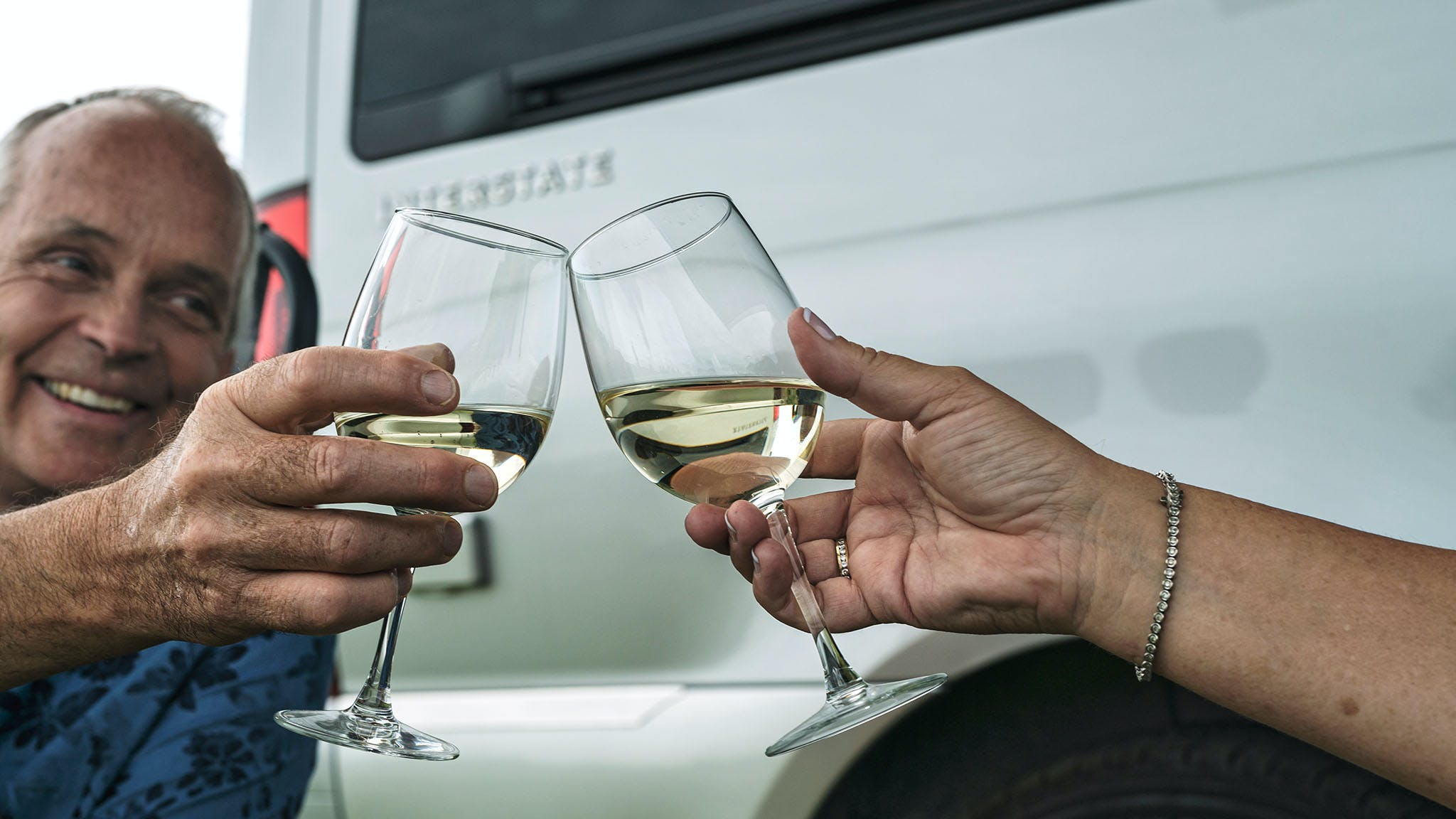 Couple Drinking White Wine Airstream Interstate