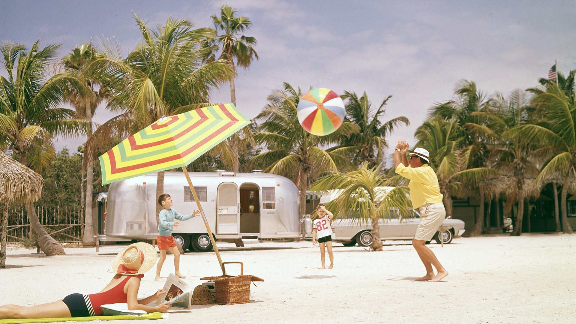 Airstream-Archives-Family-Traveling-and-Playing-Ball-on-Beach
