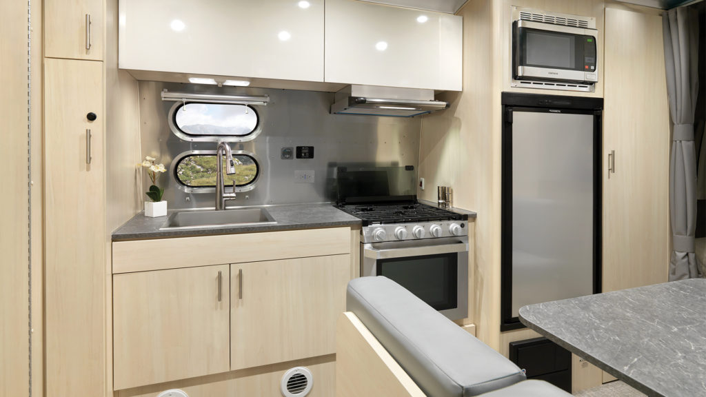 2021-Airstream-Flying-Cloud-23FB-Sunlit-Maple-Cabinetry-Storage-and-Kitchen-Seattle-Mist-Decor