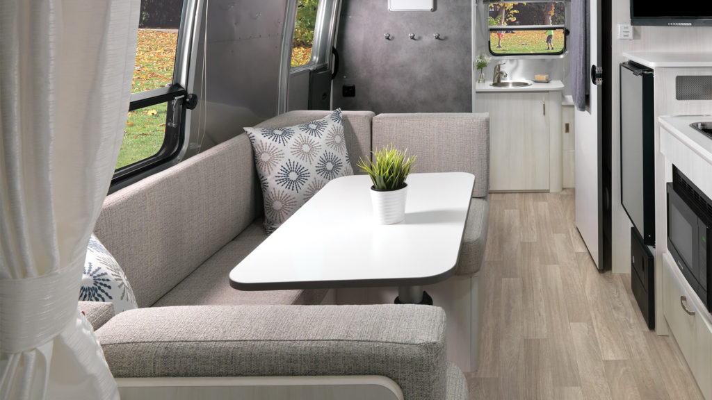 Airstream-Bambi-22FB-Dune-Interior-Dinette-and-Conversion-Bed-Featured-Hotspot