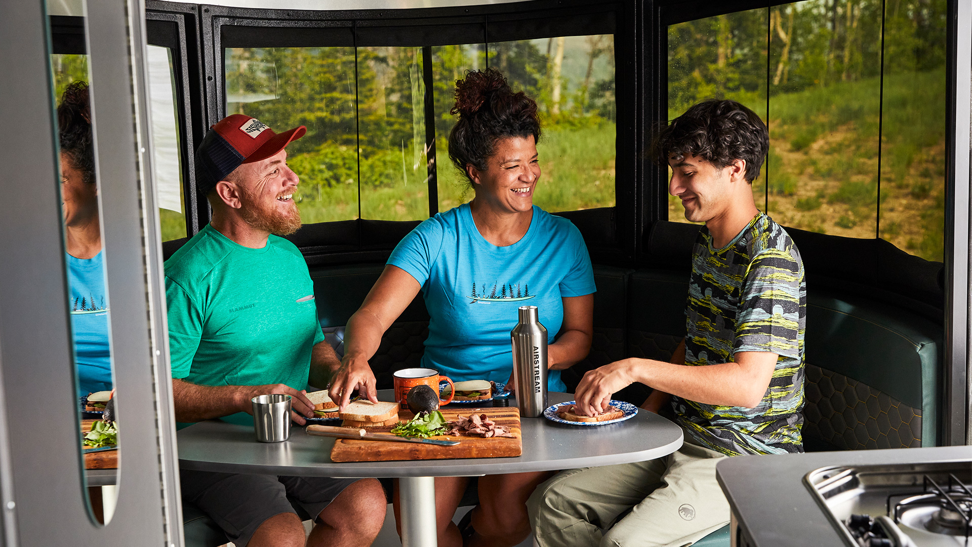 Airstream-Basecamp-20-Front-Dinette-up-in-Eating-Position-with-Family