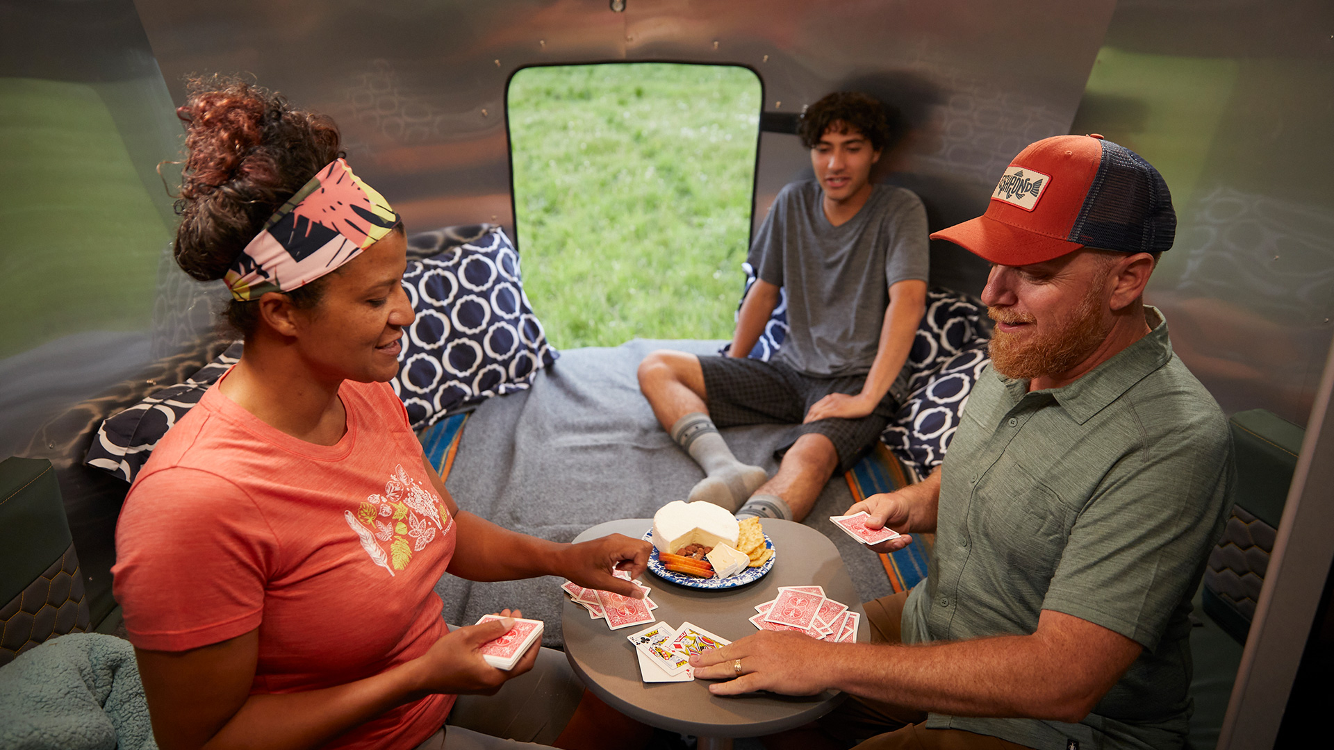 Airstream-Basecamp-Rear-Bed-and-Dinette-1-Table-Up-Transition