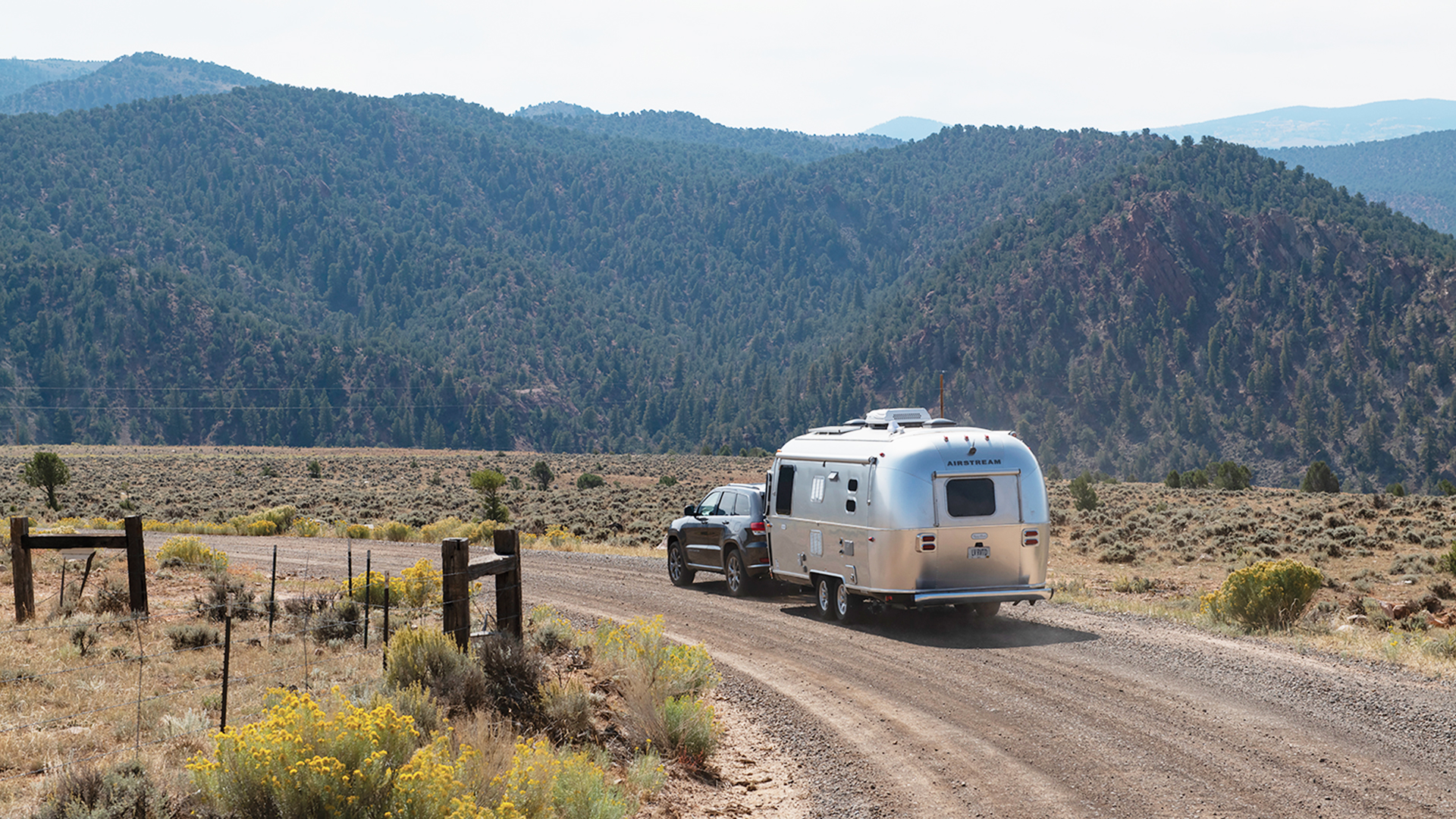Airstream-Travel-Trailer-with-Mountains-Driving