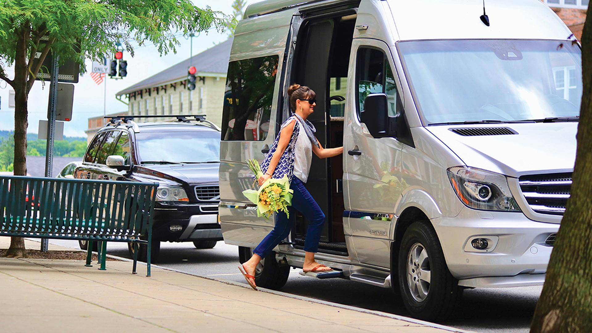 Woman walking into Airstream Interstate Nineteen