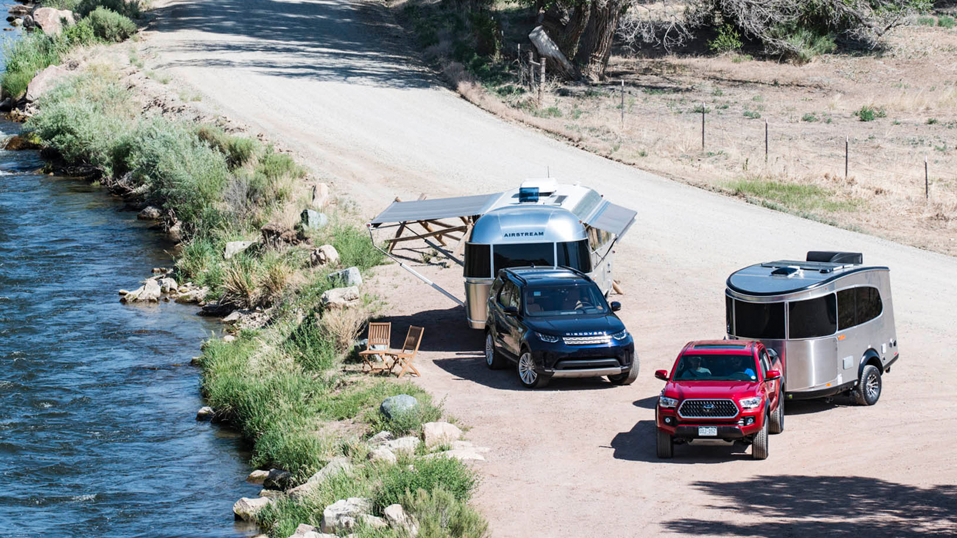 An SUV and a truck pulling Airstream trailers