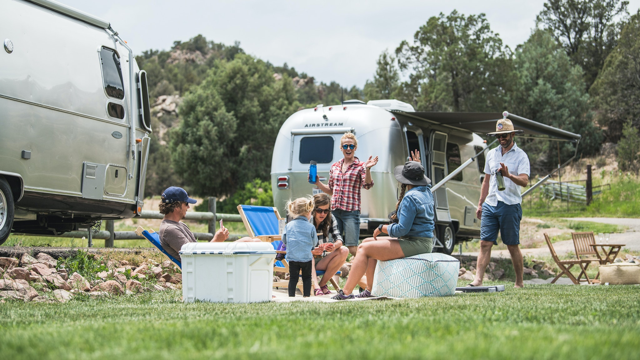 People hanging out outside their Airstream Trailers