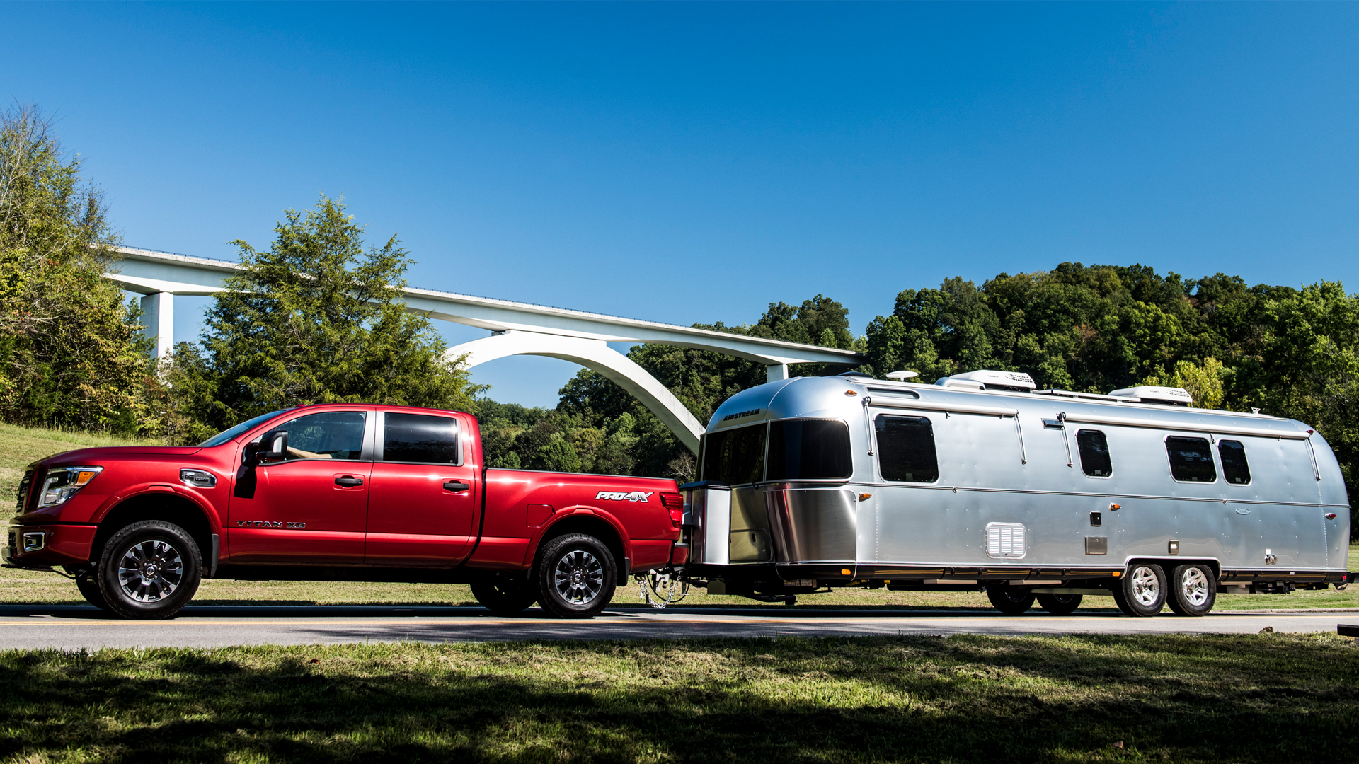 red-truck-towing-an-airstream-trailer
