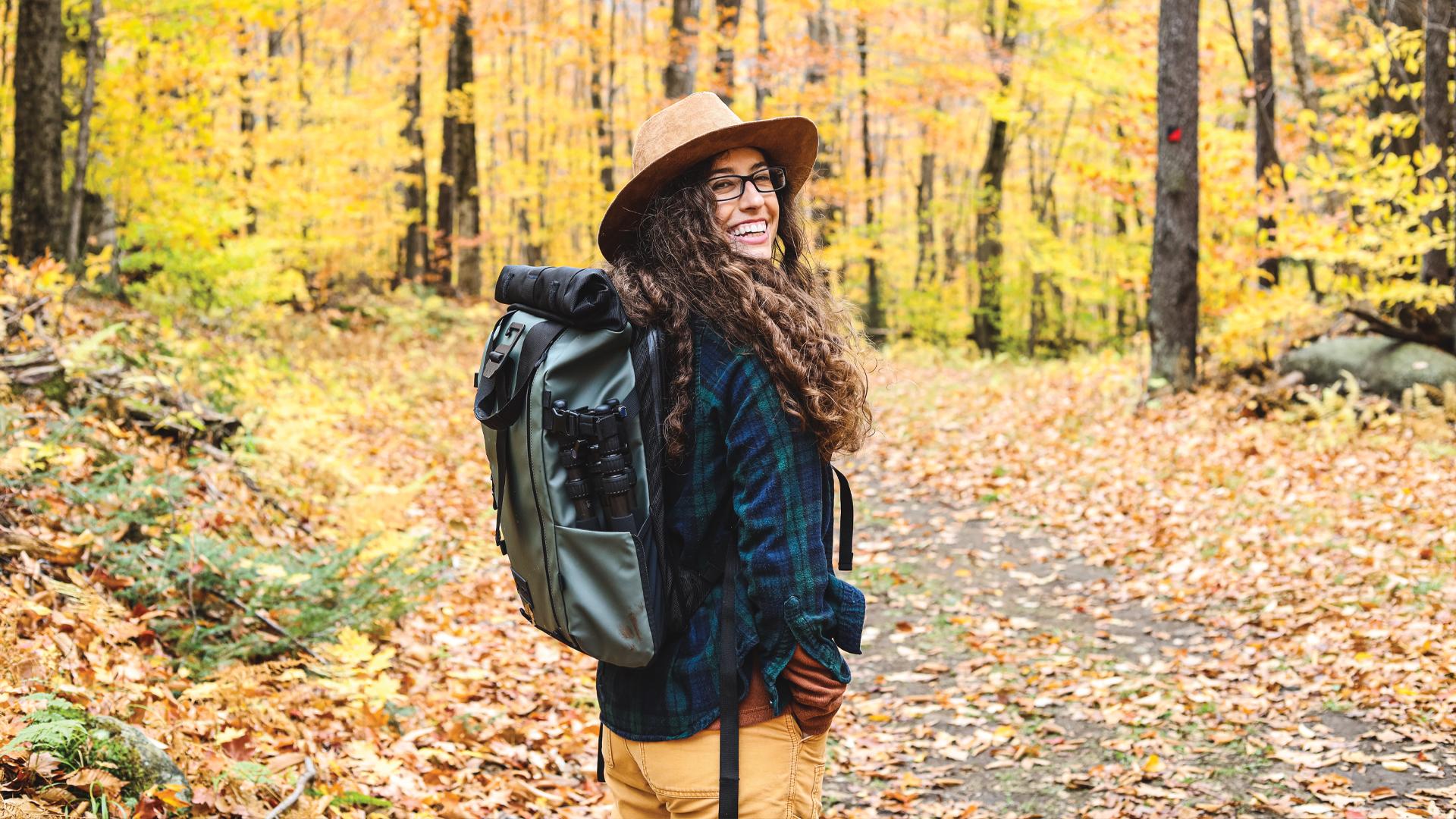 Airstream Ambassador Marisa hiking through the woods