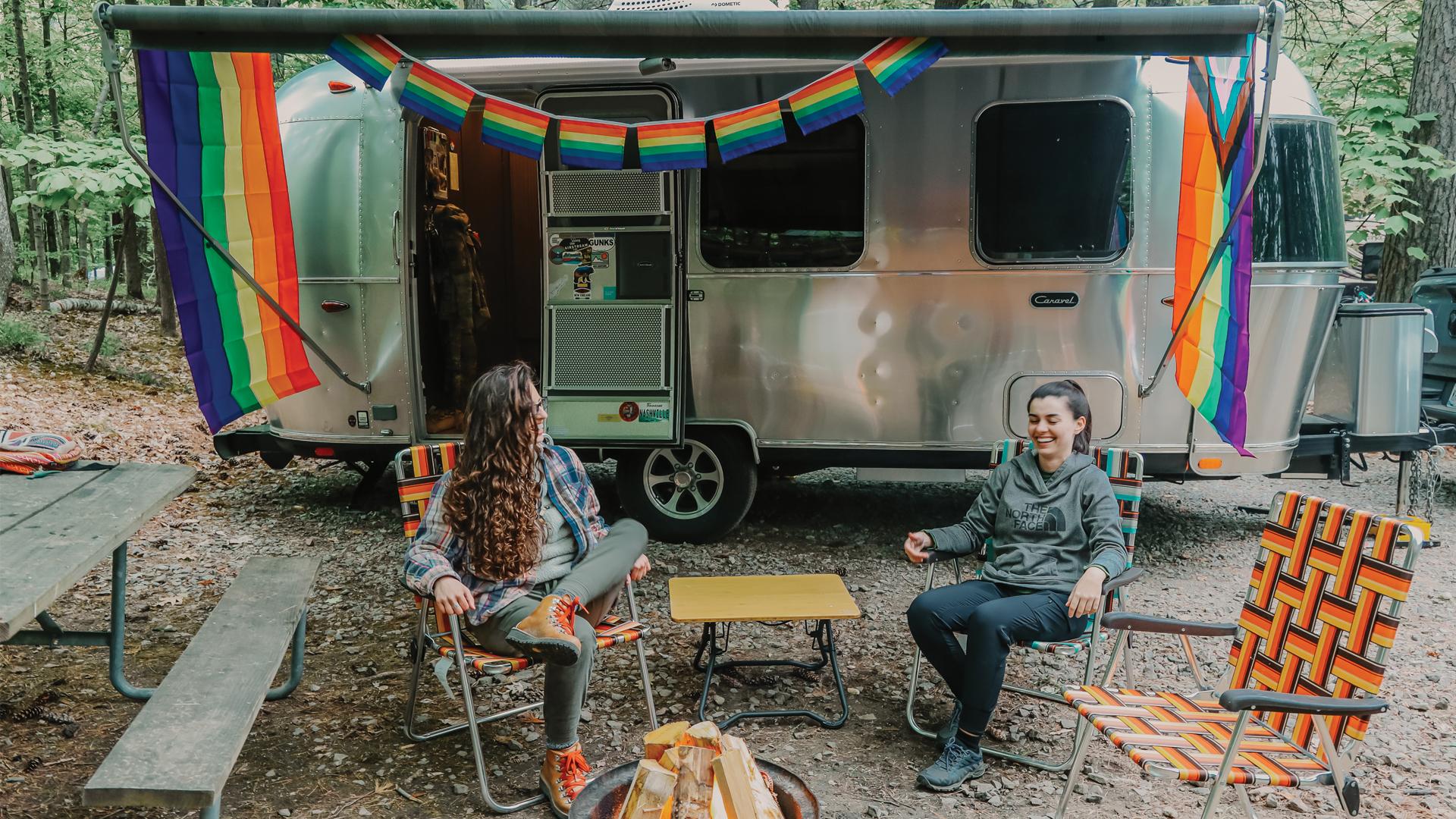 Airstream Ambassador Marisa and her girlfriend sitting outside of her Airstream Travel Trailer