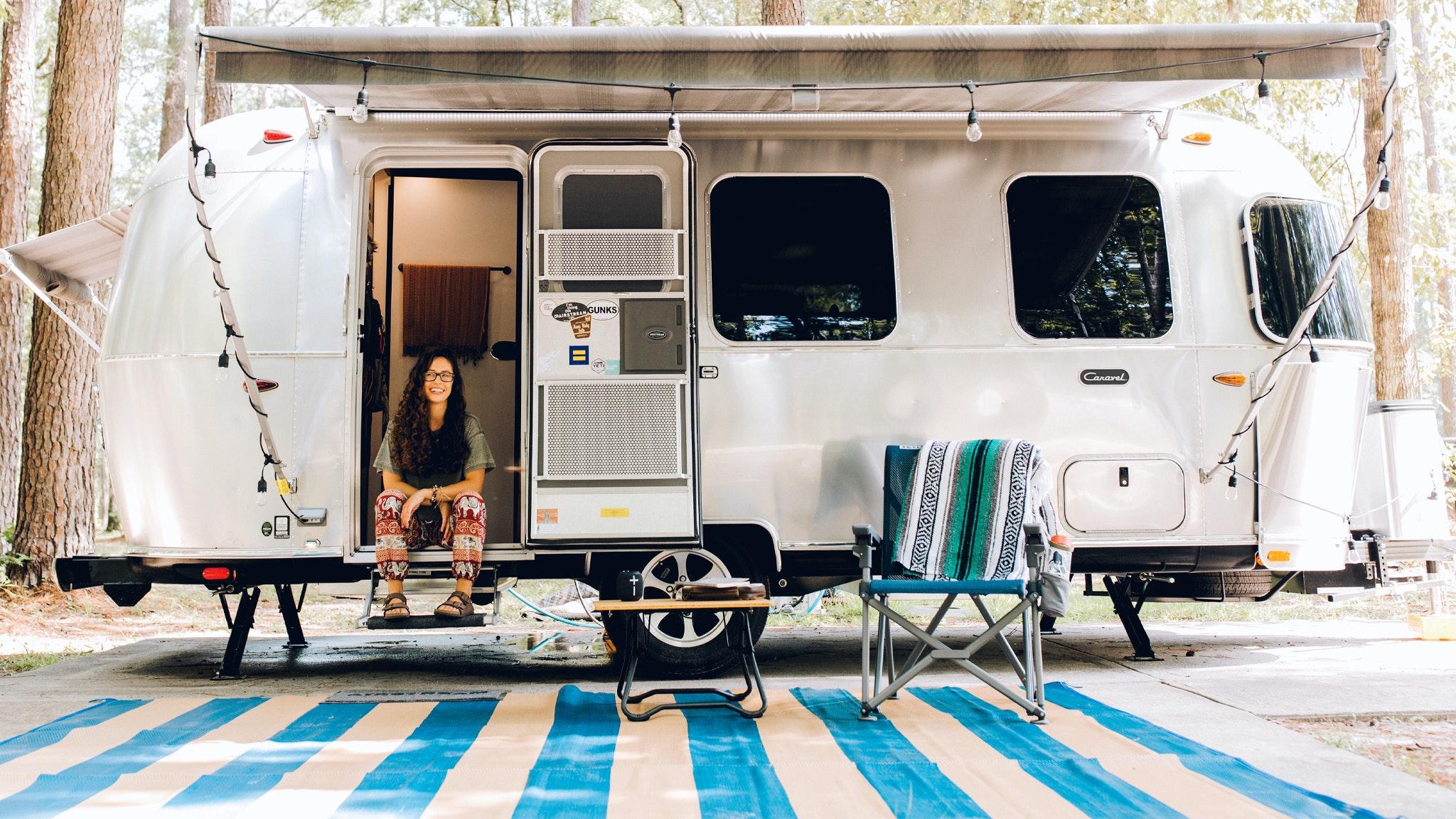 Airstream Ambassador Marisa sitting on the steps of her Airstream Travel Trailer