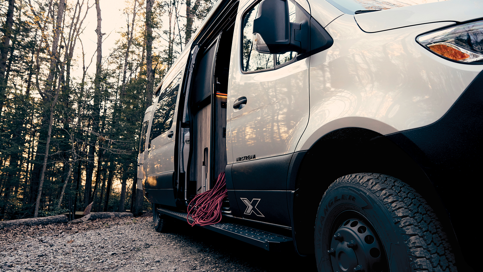Airstream-Interstate-24X-Curb-Side-Exterior-with-Door-Open-Lifestyle