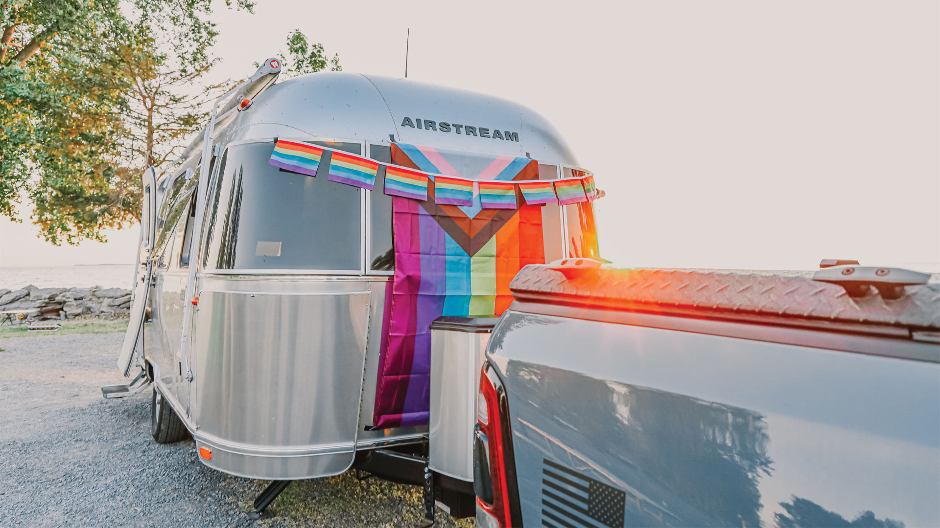 Pride flags hanging on an Airstream Travel Trailer