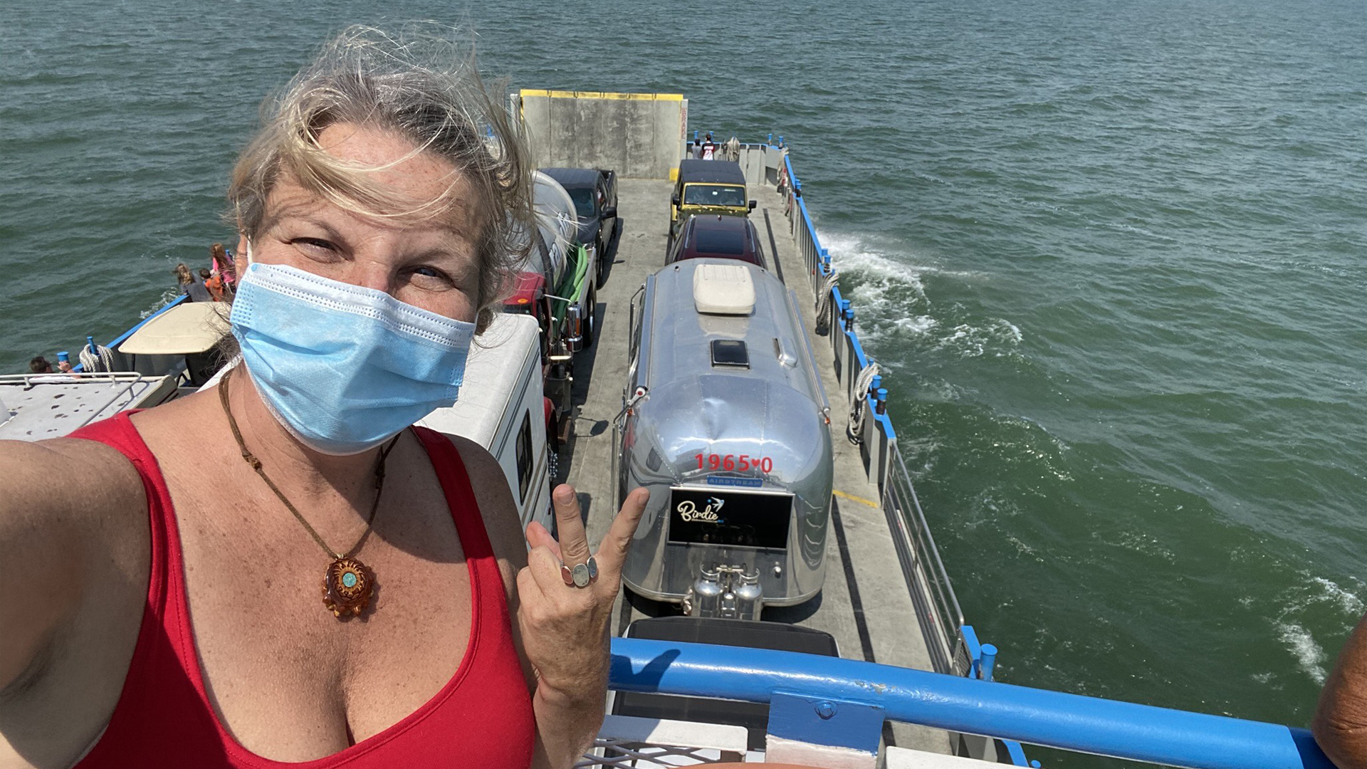 Lindy B on a boat with her Airstream while she travels around the world