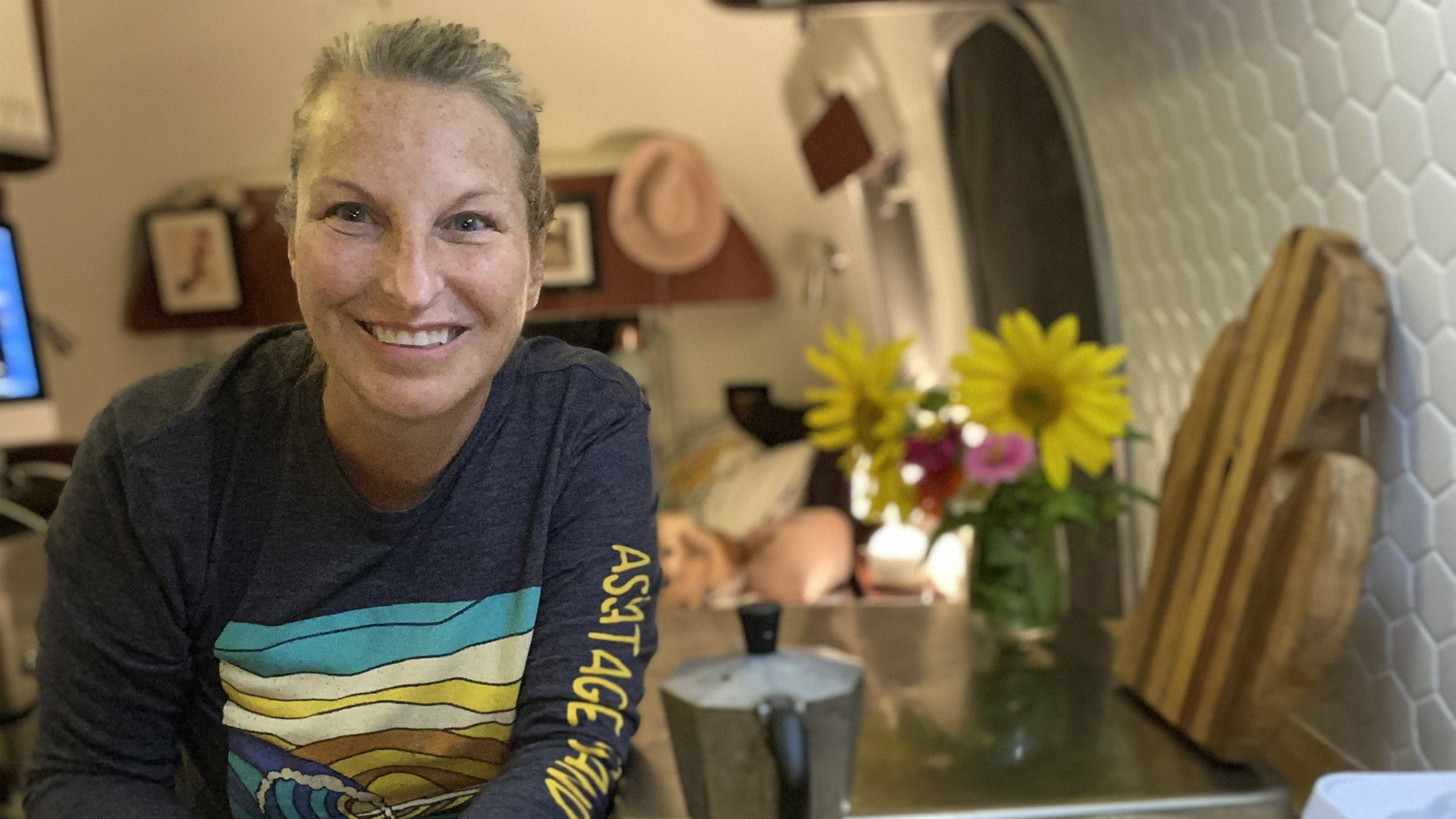 Lindy B sitting in her Airstream