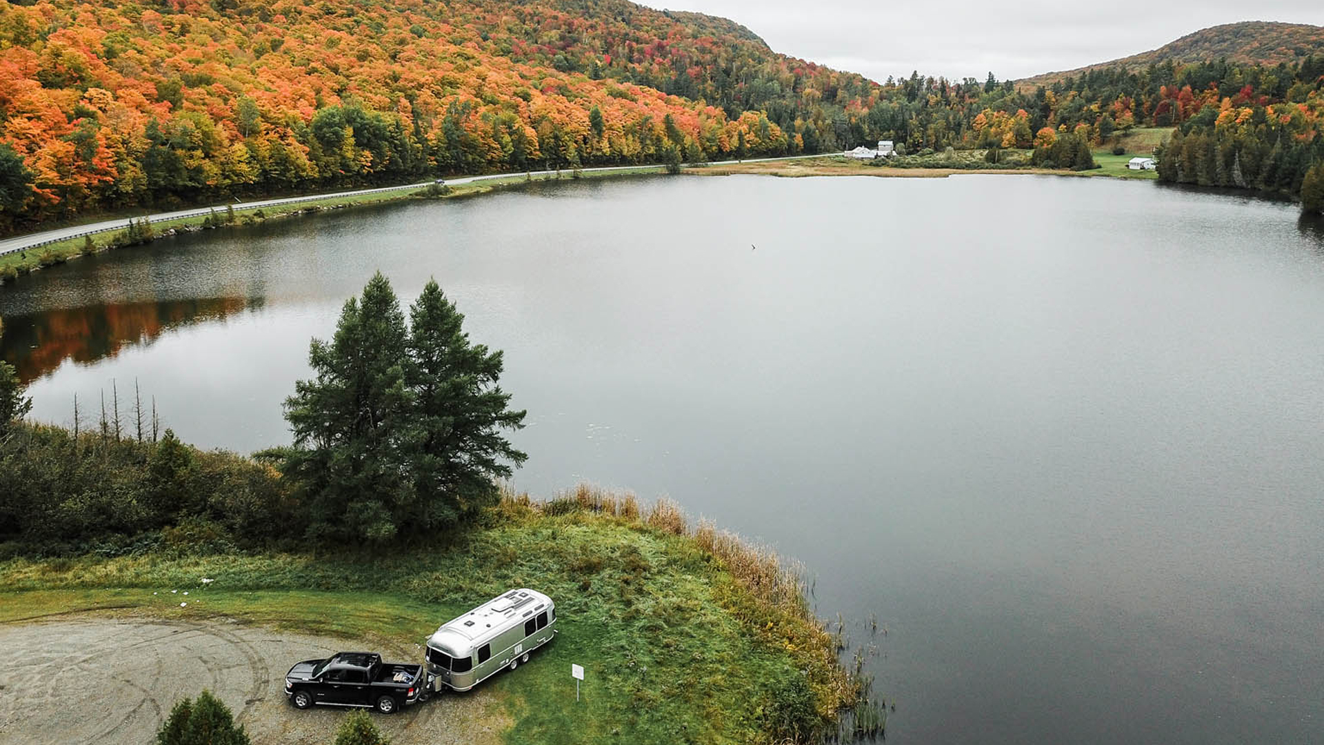 Airstream Travel Trailer at a campground in the fall by a lake